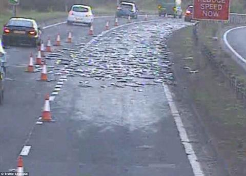 Van sheds load of fish over A737 near Johnstone