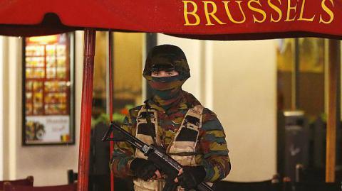 Paris suspect Salah Abdeslam still on the run after evading Belgian police raids