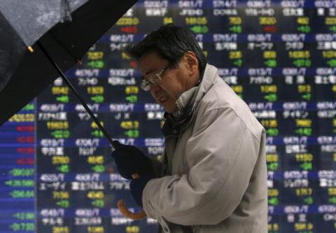 Asian stocks slide to four-year lows as oil spirals lower