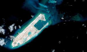 Beijing places missile launchers on disputed South China Sea island
