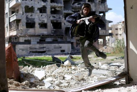 Putin's plan to pull troops from Syria puts pressure on Assad