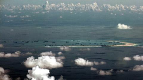 Malaysia says 100 China boats intrude into its waters