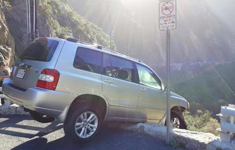 Man escapes car dangling on Malibu cliff, only to be hit by bus