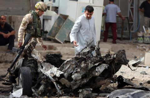 Iraq officials: Suicide bomb kills at least 13 near Baghdad