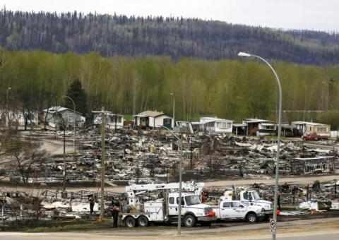 Canadian oilfield workers readying return after wildfire (PHOTO)