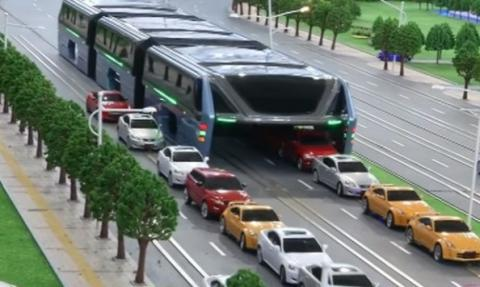 Futuristic straddling bus allows cars running underneath (VIDEO)