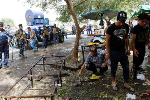 14 killed in suicide car bombing north of Baghdad