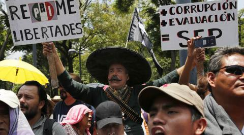 Mexican businesses shuttered stores to protest teacher's blockade
