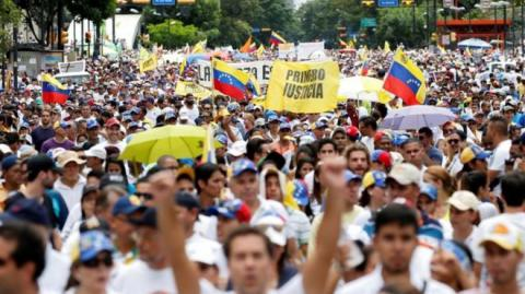 Venezuela's Caracas held two rival demonstrations on Thursday