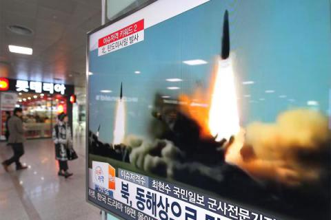 South Korea reports North launches three missile into sea