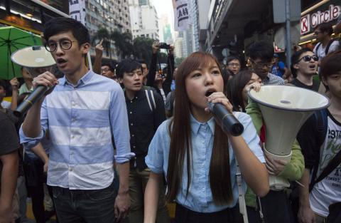 Two Hong Kong lawmakers barred from office by Beijing