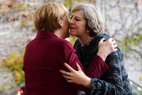 Angela Merkel rebuffs Theresa May's plea for deal for Brits living in the EU as MPs write to Brussels urging talks on an agreement