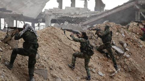 Syrian jihadists kill scores of insurgents