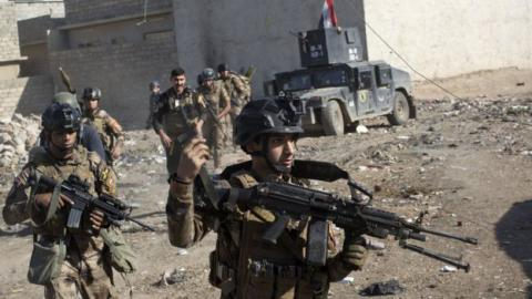 Iraqi army, allies besiege IS stronghold in western Mosul