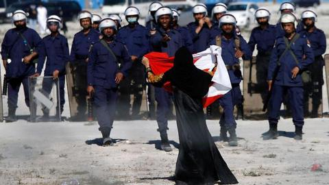 Bahrain bans opposition, transfers many civilian cases to military court