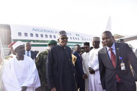 Nigeria's president returns after weeks on medical leave
