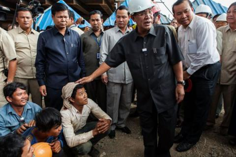 Cambodia leader tells critics to pay up, or pack up