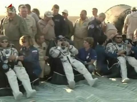 Record-breaking spacewoman returns to Earth