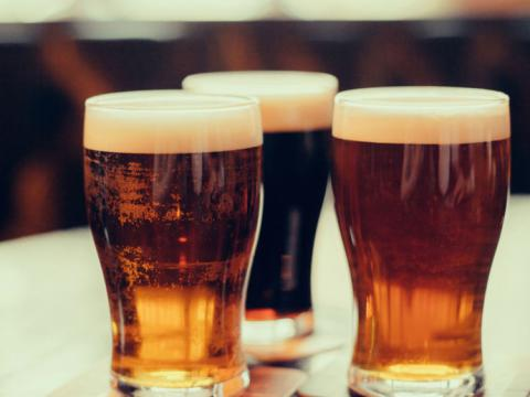 Alcohol industry 'playing down' risk of cancer